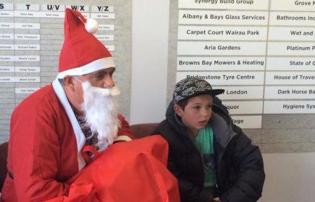 Ian Mellett - an Auckland Lawyer, wearing his Santa Suite at a local community gathering for South Aricans living in New Zeland.